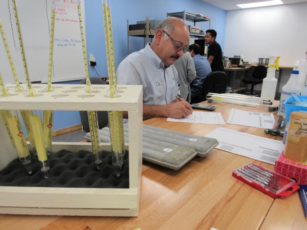 Senior Tech Calibrating Hydrometers